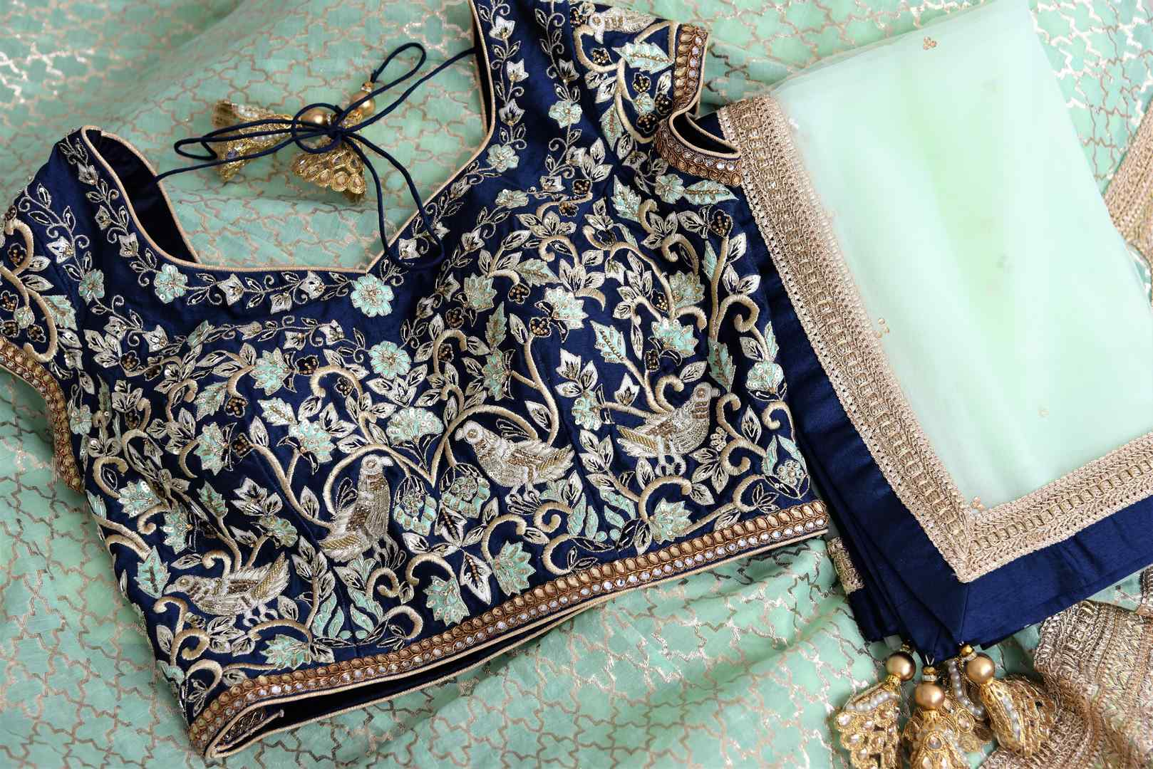 Buy pastel green and blue embroidered chanderi lehenga with dupatta online in USA. Add brilliance to your Indian wedding look with an exquisite range of designer wedding lehengas available at Pure Elegance exclusive clothing store in USA or shop online.-details