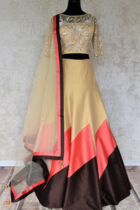 Grace this festive season with this meticulously crafted gold silk net embroidery lehenga with embellished sheer net dupatta. Bring flavour to your attire with this gorgeously handcrafted gold silk lehenga skirt. Shop graceful Indian dresses, designer silk saris, beautiful lehengas online or visit Pure Elegance in USA.-full view