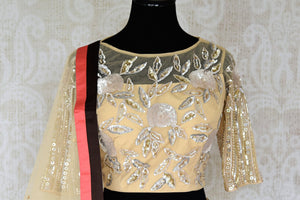 Grace this festive season with this meticulously crafted gold silk net embroidery lehenga with embellished sheer net dupatta. Bring flavour to your attire with this gorgeously handcrafted gold silk lehenga skirt. Shop graceful Indian dresses, designer silk saris, beautiful lehengas online or visit Pure Elegance in USA.-blouse dupatta