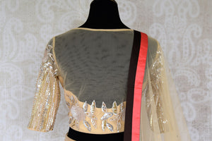 Grace this festive season with this meticulously crafted gold silk net embroidery lehenga with embellished sheer net dupatta. Bring flavour to your attire with this gorgeously handcrafted gold silk lehenga skirt. Shop graceful Indian dresses, designer silk saris, beautiful lehengas online or visit Pure Elegance in USA.-blouse back