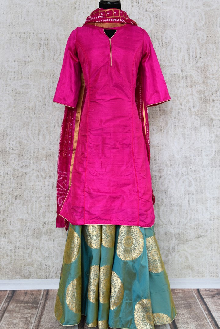 Buy pink and green raw silk kurta with Banarasi skirt online in USA and dupatta. Find more such exquisite Indian designer dresses in USA at Pure Elegance Indian fashion store. Shop now.-full view