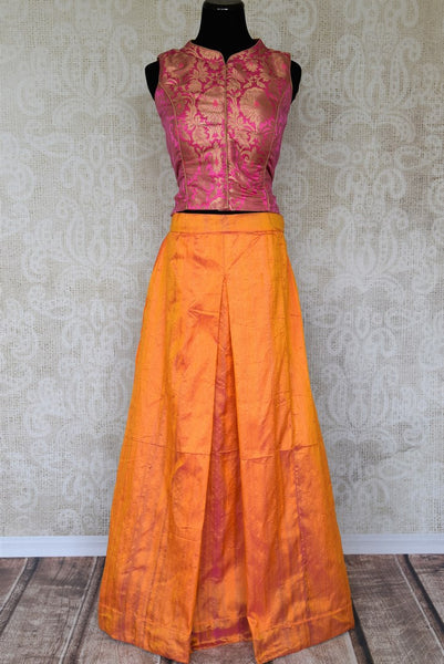 Dazzle at your BFF's wedding in this trendy Orange silk palazzo skirt with a hot pink banarsi blouse.The celeb-inspired ensemble is exquisitely designed for fashionable women. Shop beautiful and trendy Indian dresses, lehenga skirts, traditional dresses online or visit Pure Elegance store in USA. -full view
