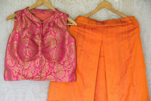 Dazzle at your BFF's wedding in this trendy Orange silk palazzo skirt with a hot pink banarsi blouse.The celeb-inspired ensemble is exquisitely designed for fashionable women. Shop beautiful and trendy Indian dresses, lehenga skirts, traditional dresses online or visit Pure Elegance store in USA. -details