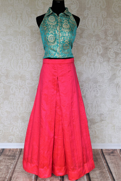 Embrace the beauty of indo-western dresses with our exclusively designed green banarsi silk blouse and pink silk palazzo skirt. Don this uber-fashionable ensemble at events and parties to unleash the diva in you. Shop designer dresses, trendy lehengas, handloom sarees online or visit Pure Elegance store in USA. -full view