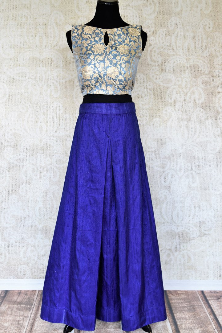 Up your ante in this designer blue raw silk palazzo skirt tailored with light blue banarsi silk blouse to add a punch of drama and ethnicity to the overall look. This indo-western dress is perfect for special events. Shop Indian dresses, designer sarees, lehenga skirts online or visit Pure Elegance store in USA. -full view