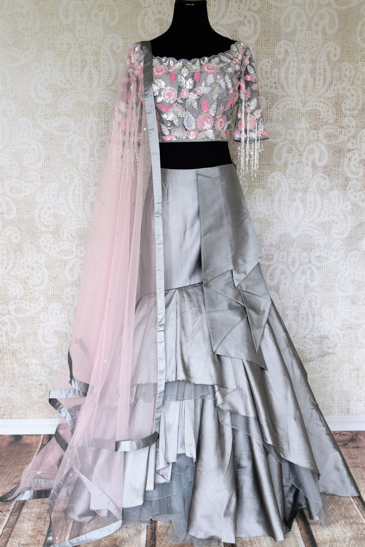 Dress up pretty in this gorgeous grey pure silk lehenga with contemporary flares at the bottom. The dreamy designer blouse featuring delicate tiki work and floral embellishments is designed for brides-to-be and bridesmaids. Shop Indian dresses, designer lehengas online or visit Pure Elegance store in USA. -full view