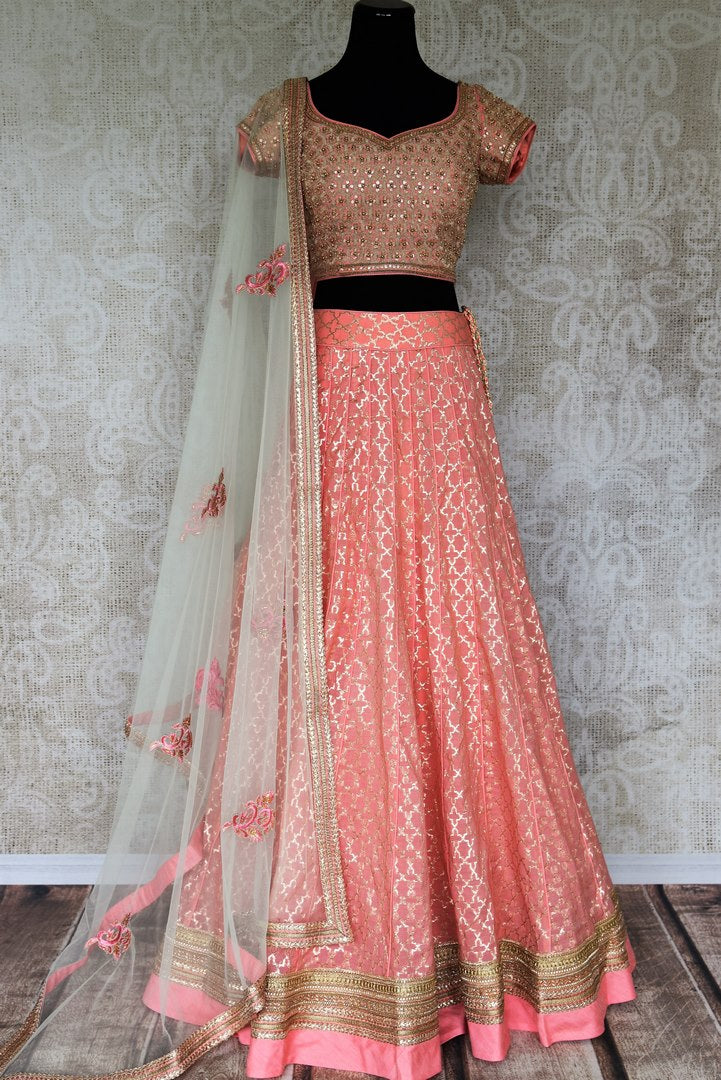 Look no less than a princess in this dreamy soft pink chanderi silk lehenga complemented with a pink zardozi embroidered blouse. A sheer net white embroidered dupatta to complete the look delicately falls on a side. Shop Indian dresses, lehenga choli, anarkali suit online or visit Pure Elegance store, USA.-full view