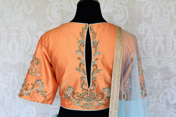 Doll up chic in this statement-worthy blue embroidery designer lehenga paired with contrasting orange embroidered designer blouse and buta work powder blue sheer net dupatta to add grace. Shop handcrafted designer dresses, indo-western dresses, lehengas online or visit Pure Elegance store in USA. -blouse back