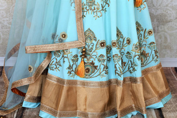 Doll up chic in this statement-worthy blue embroidery designer lehenga paired with contrasting orange embroidered designer blouse and buta work powder blue sheer net dupatta to add grace. Shop handcrafted designer dresses, indo-western dresses, lehengas online or visit Pure Elegance store in USA. -lehenga skirt