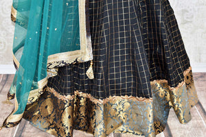 Heavily ornamented royal blue silk lehenga with checkered details and banarsi border comes with a gorgeous blue and beige silk embroidered blouse. Let the teal sequinned net dupatta fall immaculately for the feminine look. Shop designer sarees, lehenga cholis, Indian dresses online or visit Pure Elegance store, USA. -lehenga skirt