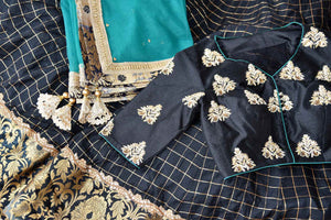 Heavily ornamented royal blue silk lehenga with checkered details and banarsi border comes with a gorgeous blue and beige silk embroidered blouse. Let the teal sequinned net dupatta fall immaculately for the feminine look. Shop designer sarees, lehenga cholis, Indian dresses online or visit Pure Elegance store, USA. -details