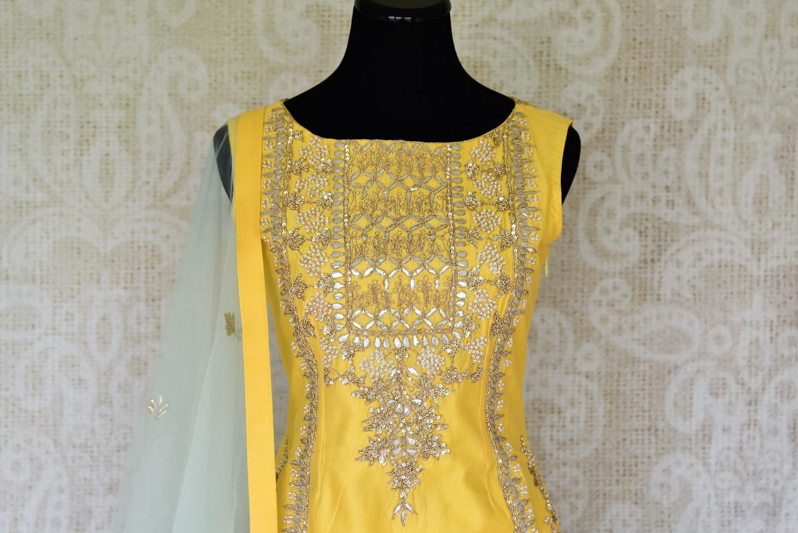 Wedding season calls for some serious indulgence and this mint green moti embroidery lehenga will not fail you. It comes with a bright yellow embroidered kurti. Drape the fancy mint green net dupatta on the side. Shop Indian dresses, anarkali suits, lehenga online or visit Pure Elegance store, USA. -kurta front