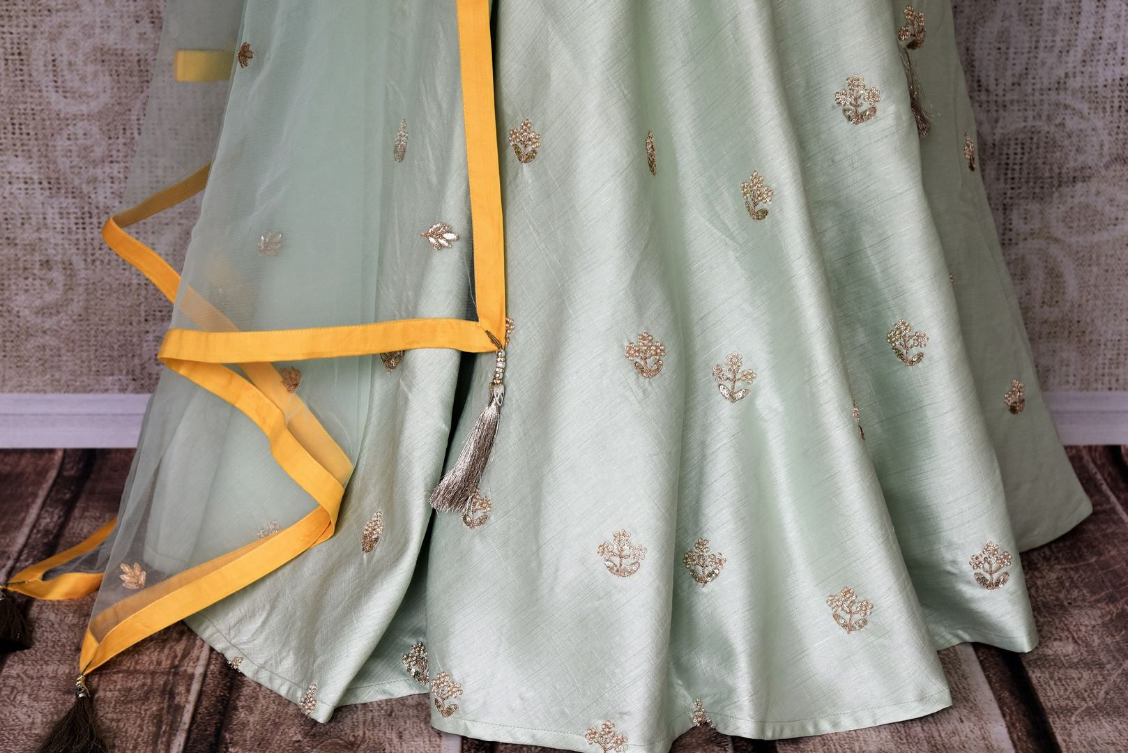 Wedding season calls for some serious indulgence and this mint green moti embroidery lehenga will not fail you. It comes with a bright yellow embroidered kurti. Drape the fancy mint green net dupatta on the side. Shop Indian dresses, anarkali suits, lehenga online or visit Pure Elegance store, USA. -lehenga skirt