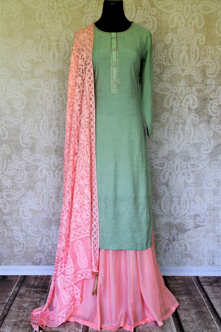 Ooze an oomph in this mint green chanderi silk sequin work long kurta. The beautifully handcrafted kurta is styled with contrasting pink flowy silk skirt. Drape the pleasing pink chikankari dupatta to complete the look. Shop designer suits, lehenga sets, Indian dresses online or visit Pure Elegance store,USA. -full view