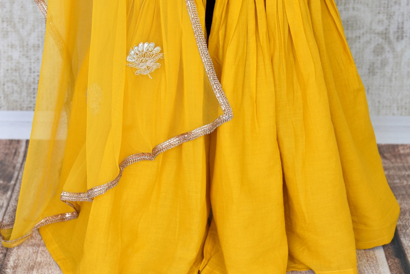 Unfold the summer sunshine with this bright yellow chanderi silk gota patti embroidered kurta and sharara pants. It's a perfect ensemble for day-time events when styled with a net yellow dupatta. Shop Indian dresses, anarkali suits, lehenga sets online or visit Pure Elegance store, USA.  -sharara
