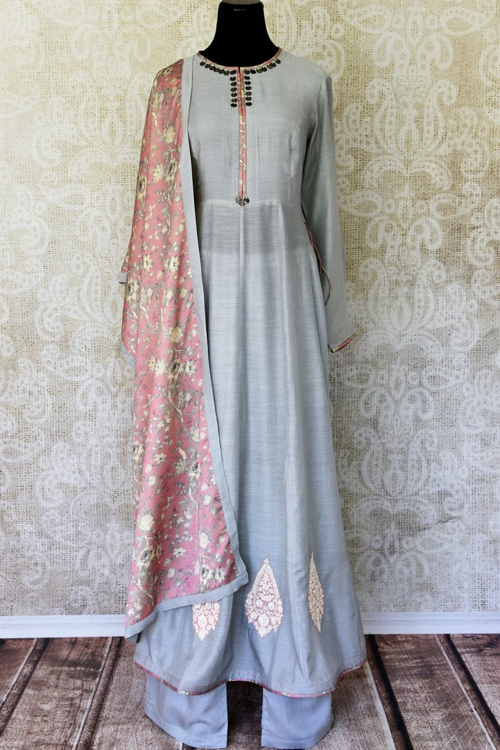Indulge in a pretty and feminine grey silk long straight kurta. Complement the attire with a pair of open wide trousers and add a beautiful peach floral dupatta over it. U Shop exclusive sarees, anarkali suits, Indian dresses online or visit Pure Elegance store, USA. -full view