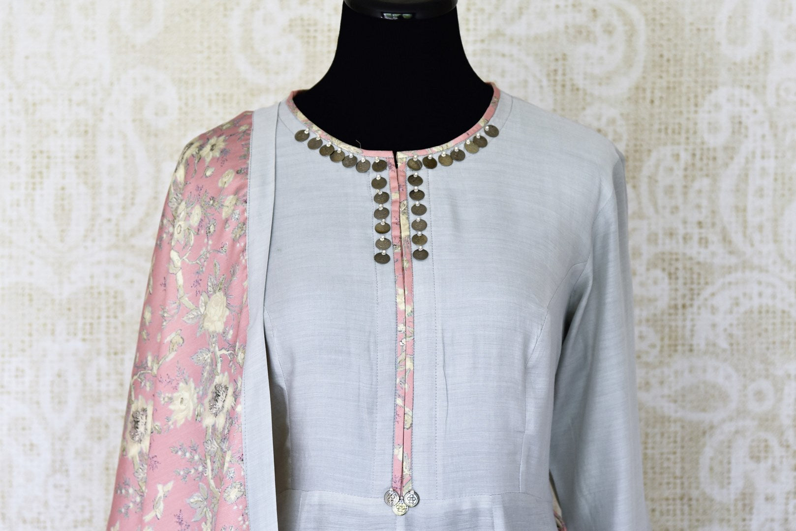 Indulge in a pretty and feminine grey silk long straight kurta. Complement the attire with a pair of open wide trousers and add a beautiful peach floral dupatta over it. U Shop exclusive sarees, anarkali suits, Indian dresses online or visit Pure Elegance store, USA. -kurta front