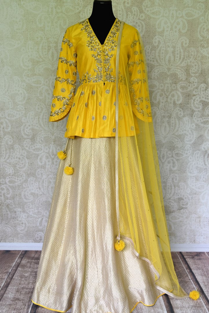 Buy yellow embroidered peplum kurti with skirt online in USA and dupatta. Make every occasion special by choosing the best of designer dresses from Pure Elegance Indian clothing store in USA, Shop from a range of stunning designer lehengas, wedding dresses, Indian clothing from our online store.-full view