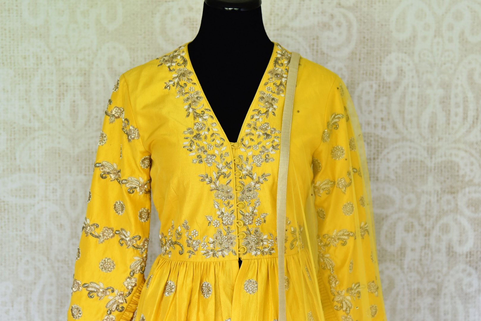 Buy yellow embroidered peplum kurti with skirt online in USA and dupatta. Make every occasion special by choosing the best of designer dresses from Pure Elegance Indian clothing store in USA, Shop from a range of stunning designer lehengas, wedding dresses, Indian clothing from our online store.-kurti front
