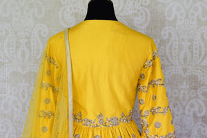 Buy yellow embroidered peplum kurti with skirt online in USA and dupatta. Make every occasion special by choosing the best of designer dresses from Pure Elegance Indian clothing store in USA, Shop from a range of stunning designer lehengas, wedding dresses, Indian clothing from our online store.-kurti back