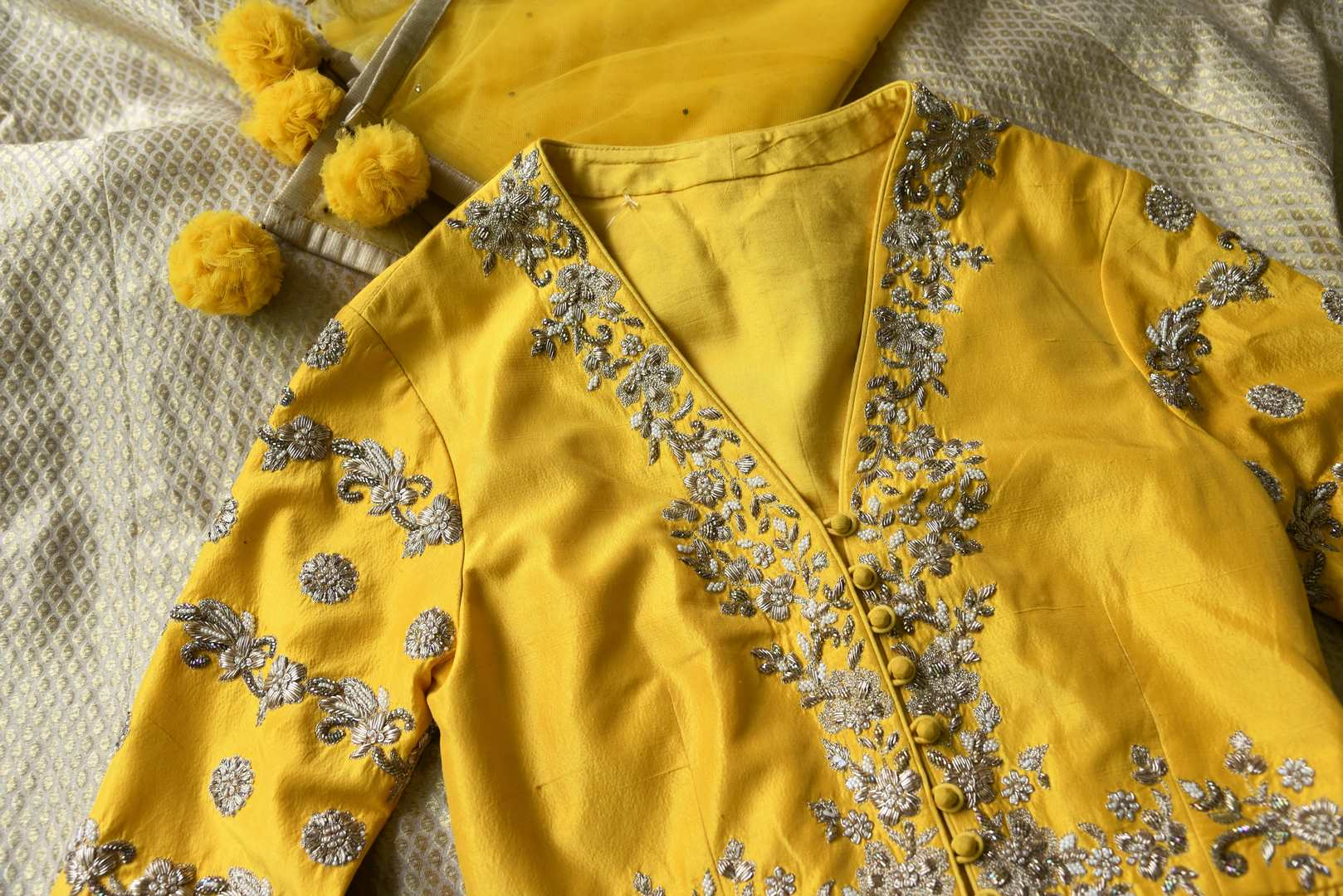 Buy yellow embroidered peplum kurti with skirt online in USA and dupatta. Make every occasion special by choosing the best of designer dresses from Pure Elegance Indian clothing store in USA, Shop from a range of stunning designer lehengas, wedding dresses, Indian clothing from our online store.-details