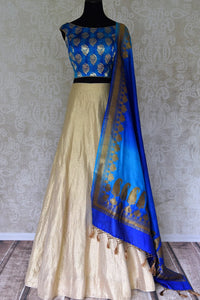 Buy gold Banarasi silk lehenga with blue sleeveless choli online in USA and dupatta. Find a range of stunning designer lehengas in USA at Pure Elegance Indian clothing store. Elevate your traditional style with a range of designer sarees, Indian clothing, and much more also available at our online store.-full view