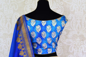 Buy gold Banarasi silk lehenga with blue sleeveless choli online in USA and dupatta. Find a range of stunning designer lehengas in USA at Pure Elegance Indian clothing store. Elevate your traditional style with a range of designer sarees, Indian clothing, and much more also available at our online store.-blouse back