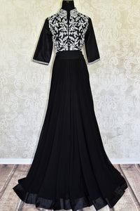 This jaw-dropping black raw silk floor-length skirt is a versatile piece for your wardrobe. Style it right with a hand embroidered floral designer monochrome blouse. Shop designer anarkali suits, kurta sets, lehenga sets online or visit Pure Elegance store, USA. -full view