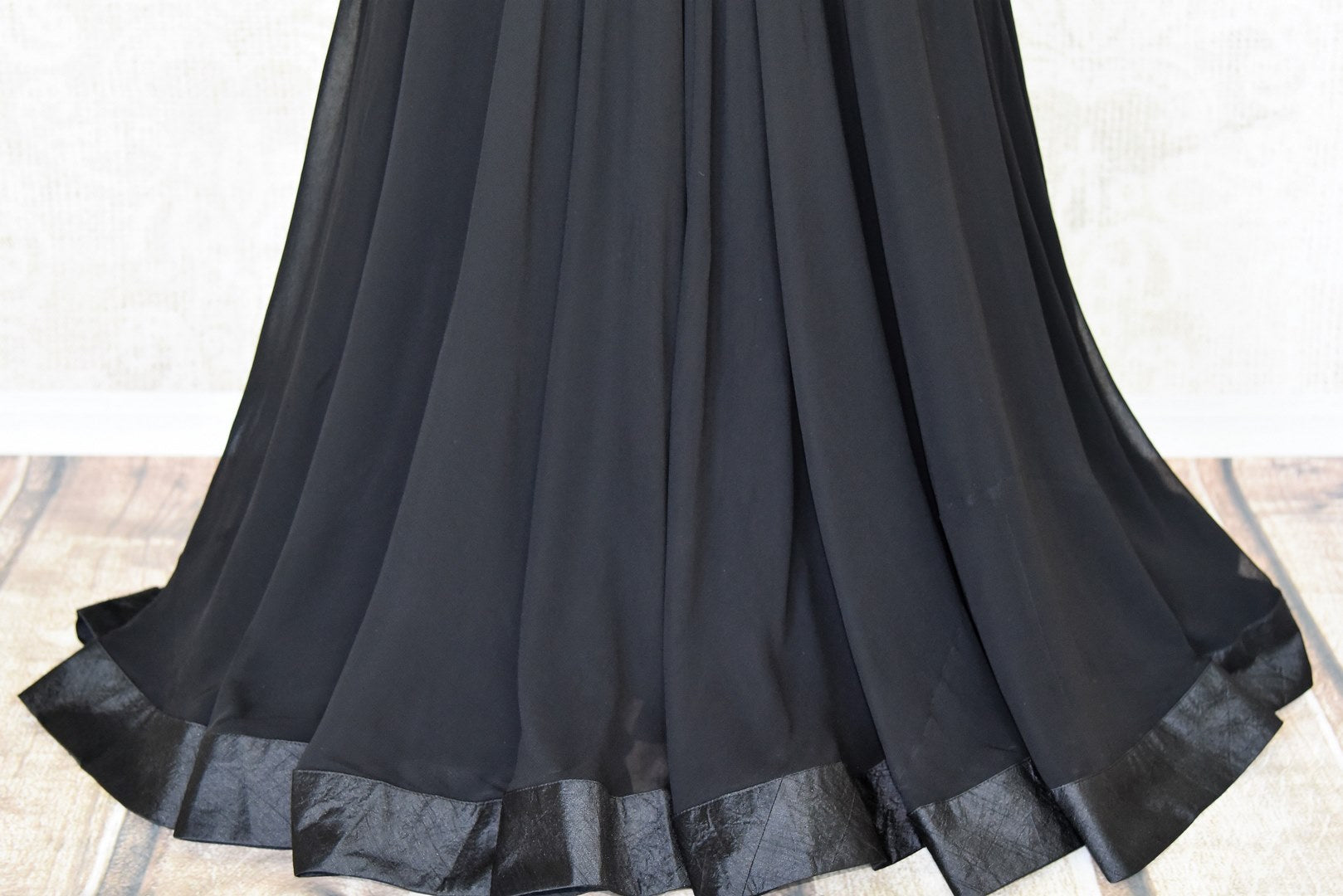This jaw-dropping black raw silk floor-length skirt is a versatile piece for your wardrobe. Style it right with a hand embroidered floral designer monochrome blouse. Shop designer anarkali suits, kurta sets, lehenga sets online or visit Pure Elegance store, USA. -skirt