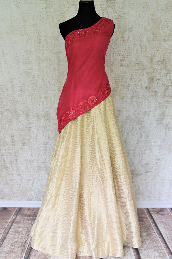 Buy online pink embroidered blouse with gold silk skirt in USA. Add style to your look with Indian designer dresses available at Pure Elegance Indian fashion store in USA or shop online.-full view