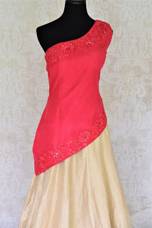 Buy online pink embroidered blouse with gold silk skirt in USA. Add style to your look with Indian designer dresses available at Pure Elegance Indian fashion store in USA or shop online.-blouse