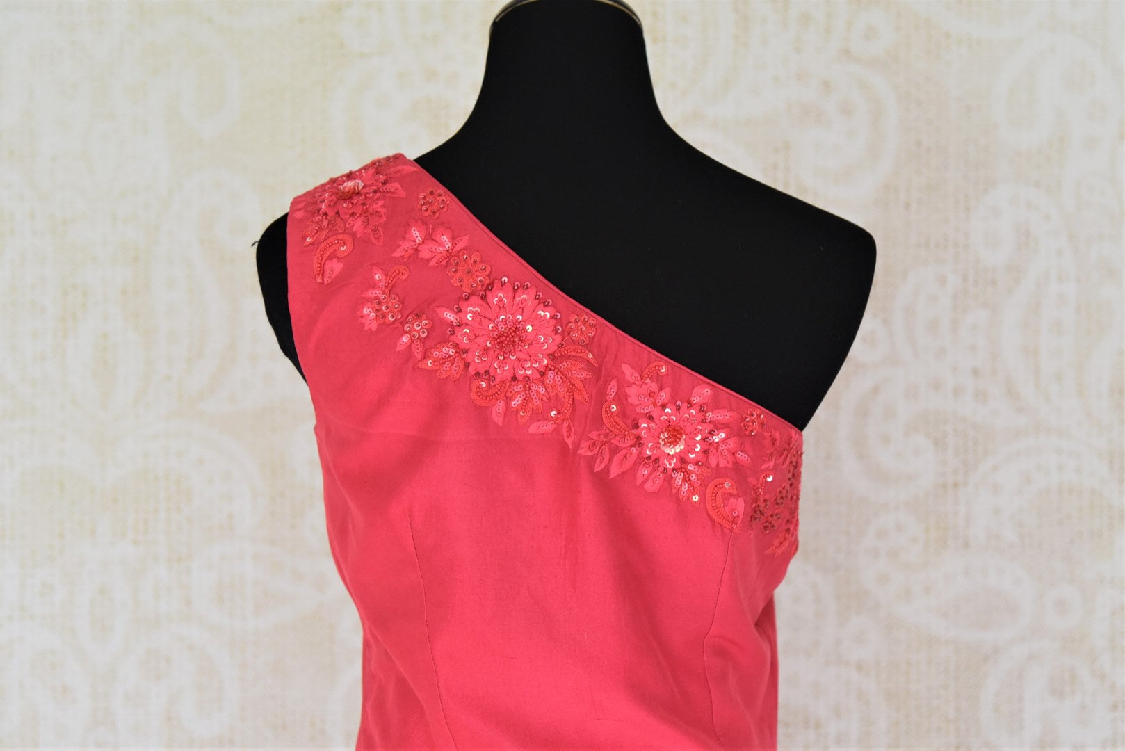 Buy online pink embroidered blouse with gold silk skirt in USA. Add style to your look with Indian designer dresses available at Pure Elegance Indian fashion store in USA or shop online.-back