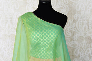 Shop green and yellow khaddi Banarasi skirt with one shoulder blouse online in USA. Adorn your style with a range of exquisite Kanchipuram silk saris from Pure Elegance clothing store in USA. We have an exquisite range of Indian designer sarees, silk sarees, Banarasi saris and many other varieties also available at our online store.-front