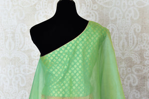 Shop green and yellow khaddi Banarasi skirt with one shoulder blouse online in USA. Adorn your style with a range of exquisite Kanchipuram silk saris from Pure Elegance clothing store in USA. We have an exquisite range of Indian designer sarees, silk sarees, Banarasi saris and many other varieties also available at our online store.-back