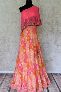Buy pink georgette khaddi lehenga online in USA with one shoulder top. Make every occasion special with beautiful Indian dresses, wedding lehengas from Pure Elegance Indian fashion store in USA. You can also browse through our website and shop online.-full view