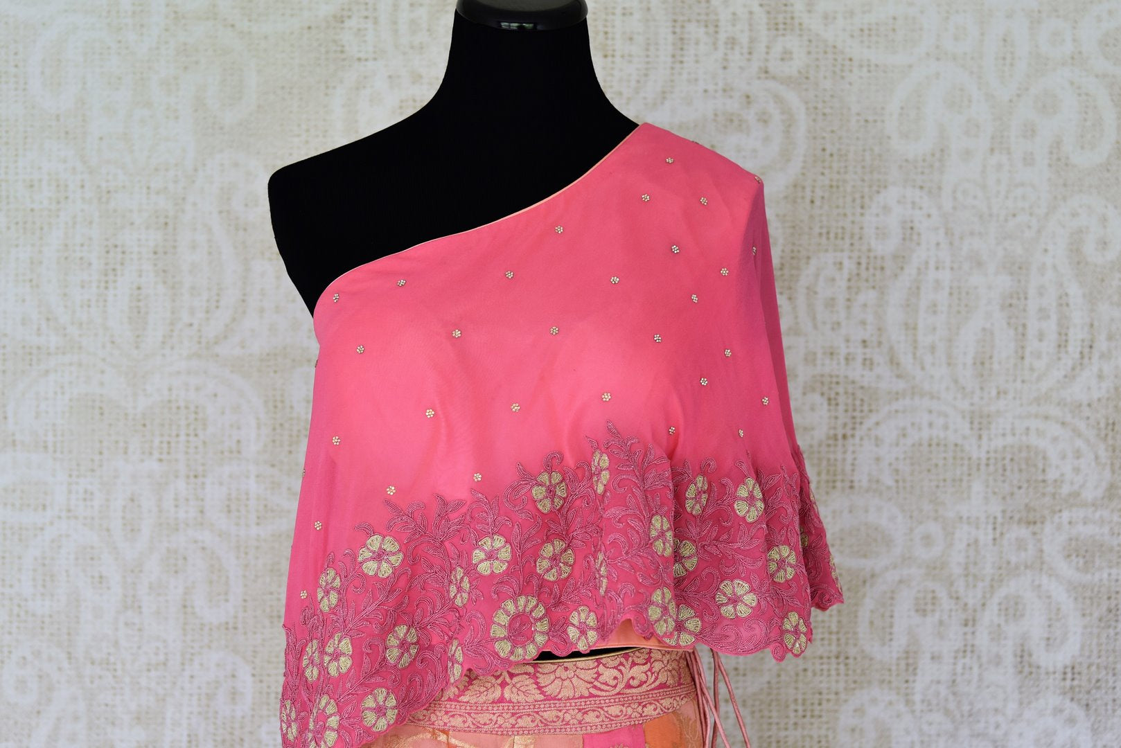 Buy pink georgette khaddi lehenga online in USA with one shoulder top. Make every occasion special with beautiful Indian dresses, wedding lehengas from Pure Elegance Indian fashion store in USA. You can also browse through our website and shop online.-side view