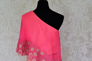 Buy pink georgette khaddi lehenga online in USA with one shoulder top. Make every occasion special with beautiful Indian dresses, wedding lehengas from Pure Elegance Indian fashion store in USA. You can also browse through our website and shop online.-side view 2