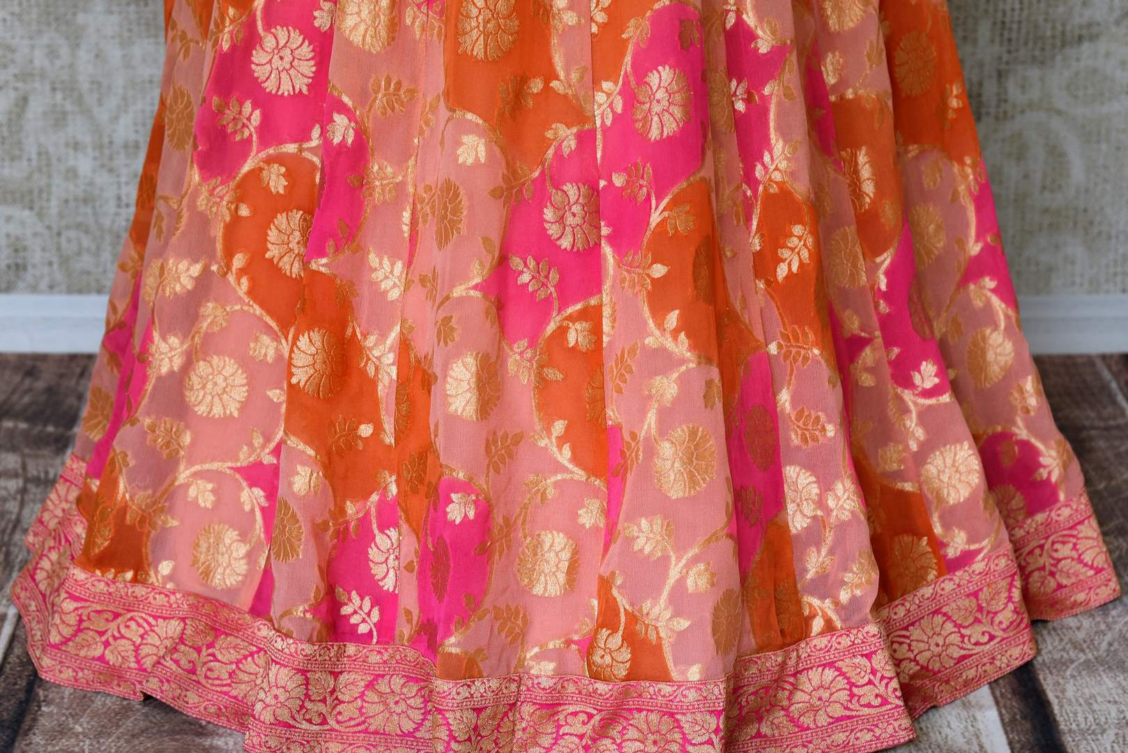 Buy pink georgette khaddi lehenga online in USA with one shoulder top. Make every occasion special with beautiful Indian dresses, wedding lehengas from Pure Elegance Indian fashion store in USA. You can also browse through our website and shop online.-skirt