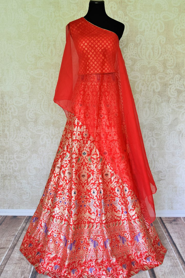 Buy red muga Banarasi lehenga online in USA with one shoulder choli. Make every occasion special by choosing the best of designer dresses from Pure Elegance Indian clothing store in USA, Shop from a range of stunning designer lehengas, wedding dresses, Indowestern dresses from our online store.-full view