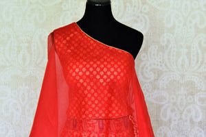 Buy red muga Banarasi lehenga online in USA with one shoulder choli. Make every occasion special by choosing the best of designer dresses from Pure Elegance Indian clothing store in USA, Shop from a range of stunning designer lehengas, wedding dresses, Indowestern dresses from our online store.-choli front