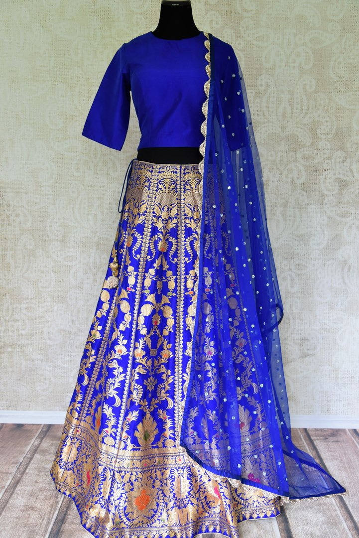 Buy ethnic blue handloom Banarasi lehenga online in USA with dupatta. Make every occasion special with beautiful Indian dresses, wedding lehengas from Pure Elegance Indian fashion store in USA. You can also browse through our website and shop online.-full view