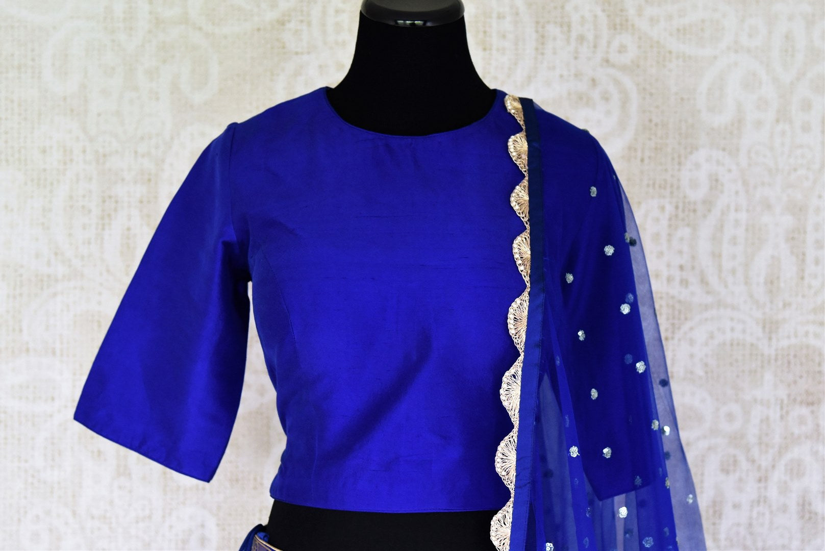 Buy ethnic blue handloom Banarasi lehenga online in USA with dupatta. Make every occasion special with beautiful Indian dresses, wedding lehengas from Pure Elegance Indian fashion store in USA. You can also browse through our website and shop online.-front