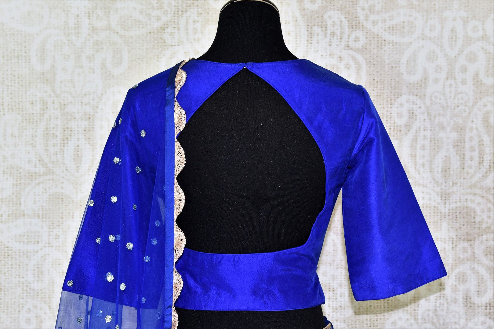 Buy ethnic blue handloom Banarasi lehenga online in USA with dupatta. Make every occasion special with beautiful Indian dresses, wedding lehengas from Pure Elegance Indian fashion store in USA. You can also browse through our website and shop online.-back
