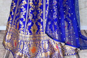 Buy ethnic blue handloom Banarasi lehenga online in USA with dupatta. Make every occasion special with beautiful Indian dresses, wedding lehengas from Pure Elegance Indian fashion store in USA. You can also browse through our website and shop online.-skirt