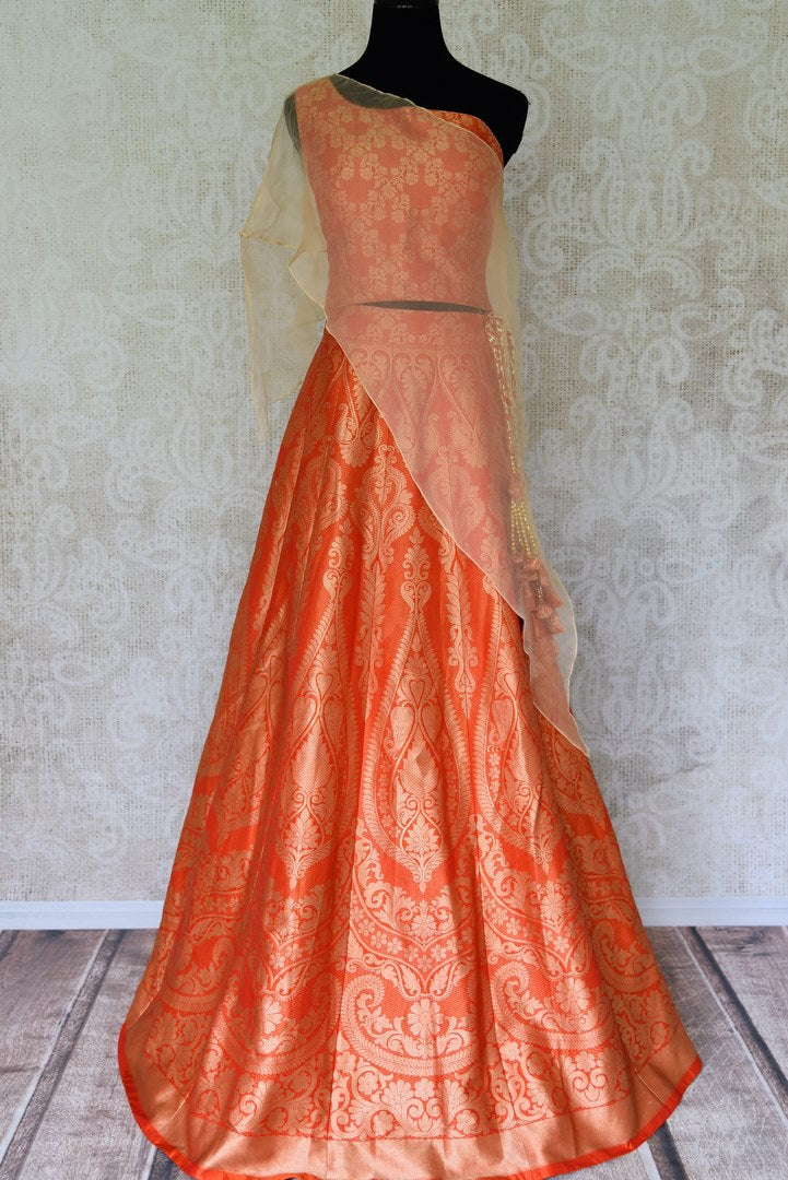 Shop orange Banarasi lehenga online in USA with organza overlay choli. Make every occasion special by choosing the best of designer dresses from Pure Elegance Indian clothing store in USA, Shop from a range of stunning designer lehengas, wedding dresses, Indowestern dresses from our online store.-full view