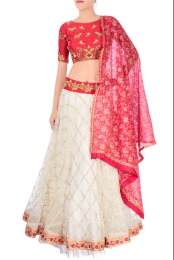 Buy off-white embroidered tule lehenga online in USA with raw silk red choli. Stand amongst the crowd with an exclusive range of Indian dresses, designer lehengas, Indowestern dresses from Pure Elegance Indian fashion store in USA or shop online.-full view