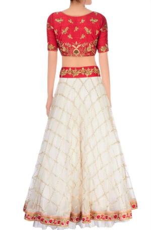 Buy off-white embroidered tule lehenga online in USA with raw silk red choli. Stand amongst the crowd with an exclusive range of Indian dresses, designer lehengas, Indowestern dresses from Pure Elegance Indian fashion store in USA or shop online.-back