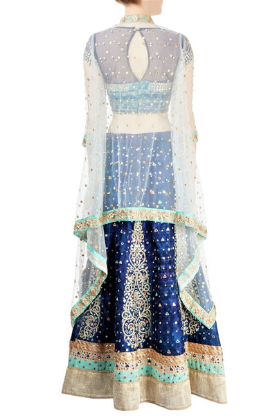 Buy captivating indigo raw silk hand embroidery lehenga with cape online in USA. Grab those eyeballs at special occasions with an exclusive range of Indian dresses, designer lehengas from Pure Elegance Indian fashion store in USA or shop online.-back