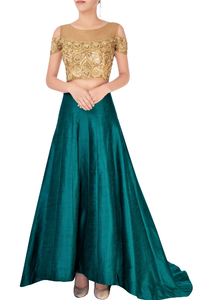 Shop green train lehenga with embroidered cold shoulder blouse online in USA. Grab those eyeballs at special occasions with an exclusive range of Indian dresses, designer lehengas from Pure Elegance Indian fashion store in USA or shop online.-full view