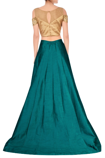 Shop green train lehenga with embroidered cold shoulder blouse online in USA. Grab those eyeballs at special occasions with an exclusive range of Indian dresses, designer lehengas from Pure Elegance Indian fashion store in USA or shop online.-back